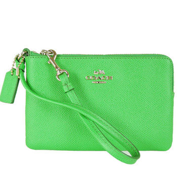 COACH 立體馬車LOGO皮革手拿包(螢光綠)