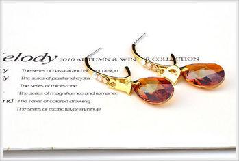 新光飾品-新款施華洛水晶黃色水滴風情耳環