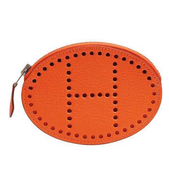 HERMES Evelyne系列山羊皮鏤空洞洞橢圓造型萬用零錢包(橘色-Q年)