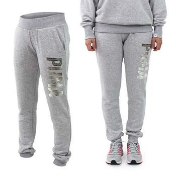 【PUMA】女基本系列FOIL束口長褲-慢跑 路跑 保暖 刷毛 灰銀