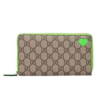 GUCCI 經典雙G圖紋X簍空愛心PVC防水皮革拉鍊折疊長夾(螢光綠)323224-9696
